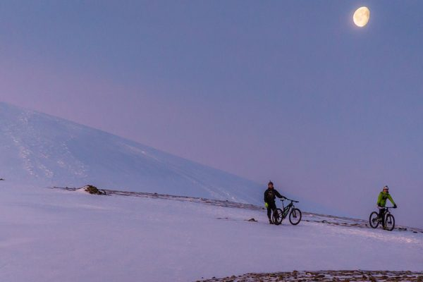The snow-capped summit appeared almost moon-like.